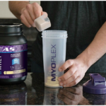 Consuming the EAS Pure Whey Protein Powder